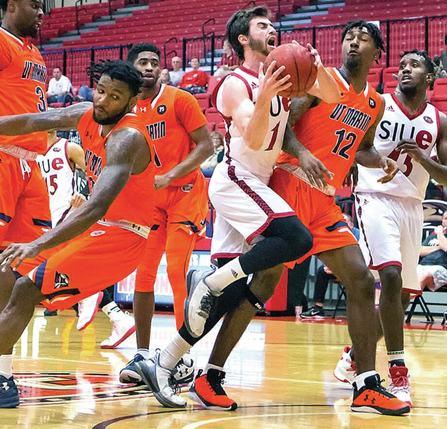 SIUE's Burak Eslik drives through the UT Martin defense to put up a shot during Ohio Valley Conference action Saturday at the Vadalabene center at SIUE. Eslik, a senior and former Lewis and Clark Community College Trailblazer, scored 25 points in his team's 80-73 loss.
