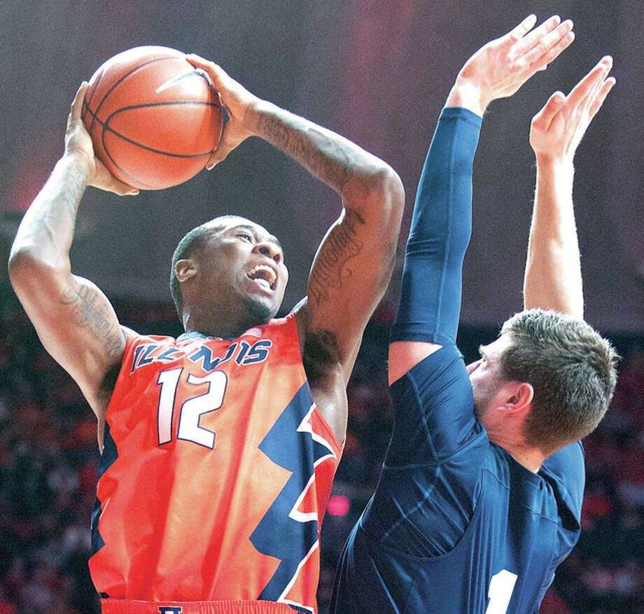 Illinois forward Leron Black (12) shoots as Penn State's forward Deividas Zemgulis Saturday in Champaign. Photo: AP