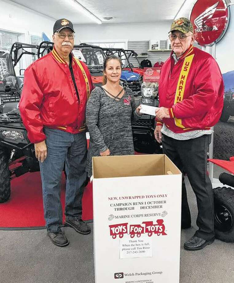 The Honda Riders Club and Sports City of Jacksonville recently donated nearly $200 to the Toys for Tots program to help less fortunate children have a better Christmas. Maria Hill of Sports City presented the donation to Tim Ritzo (left) and Earl Turner. Photo: Photo Provided