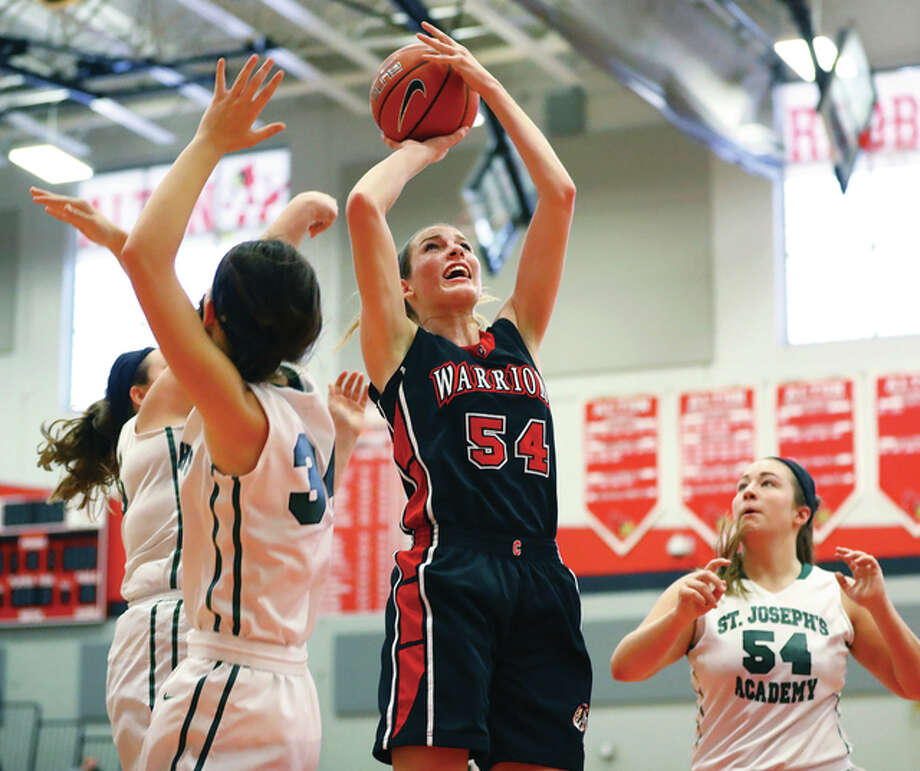 Calhoun's Grace Baalman (middle) finds room in traffic in the lane against St. Joseph's Academy defenders Annie Lally (left), Alex Kerr and Kelly McLaughlin (right) during the Alton Shootout on Jan. 16 at Alton High in Godfrey. The 24-6 Warriors take on No. 1-ranked Lebanon in a Calhoun Class 1A Sectional semifinal Tuesday in Hardin. Photo: Billy Hurst / For The Telegraph