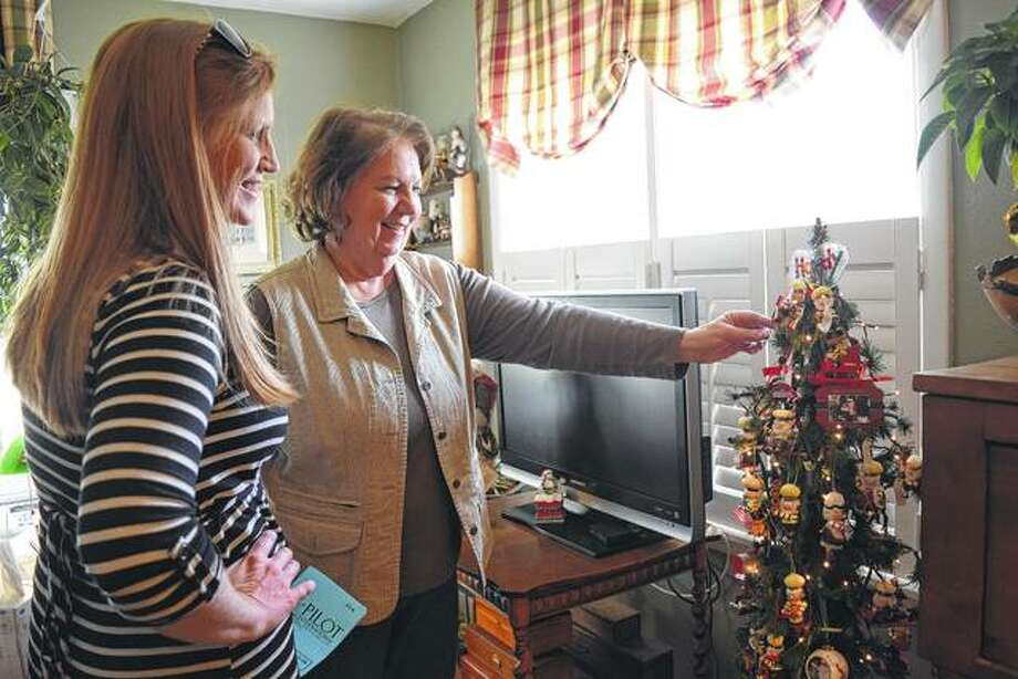 Ginnie Yording, right, and Linsey Ryan, left, of Jacksonville inspect the Hersey's Kiss-themed Christmas tree at the home of Sue Morrow Sunday during the Pilot Club's 34th annual home tour and tea. Photo: Audrey Clayton | Journal-Courier