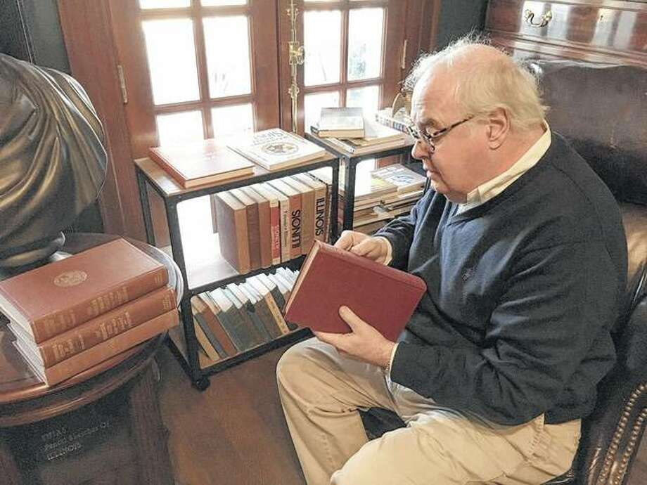 Tony Leone, a former Illinois House clerk and owner of a historic bed and breakfast near the Capitol, peruses a five-volume history of Illinois published 100 years ago for the state's centennial. Sunday marked the state's 199th birthday and the kickoff to a yearlong celebration leading up to the state's bicentennial.