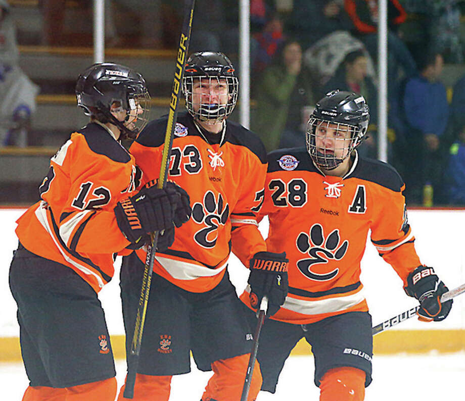 "Edwardsville's Lucas Tucker (73) scored the game-winning goal for Edwardsville in Tuesday's extra ""mini-game"" used the settle the Mid-States Hockey Association quarterfinal series against Marquette of St. Louis at the Hardee's Iceplex in Chesterfield. He is shown celebrating a playoff goal last season with teammates Stanley Lucas (12) and Rory Margherio (28). Photo: File Photo"
