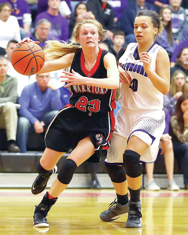 Calhoun's Junie Zirkelbach, left, drives to the basket past Lebanon's Kendra Bass during the Calhoun Class 1A Sectional semifinal game in Hardin. Calhoun won 61-50. Photo: Billy Hurst | For The Telegraph