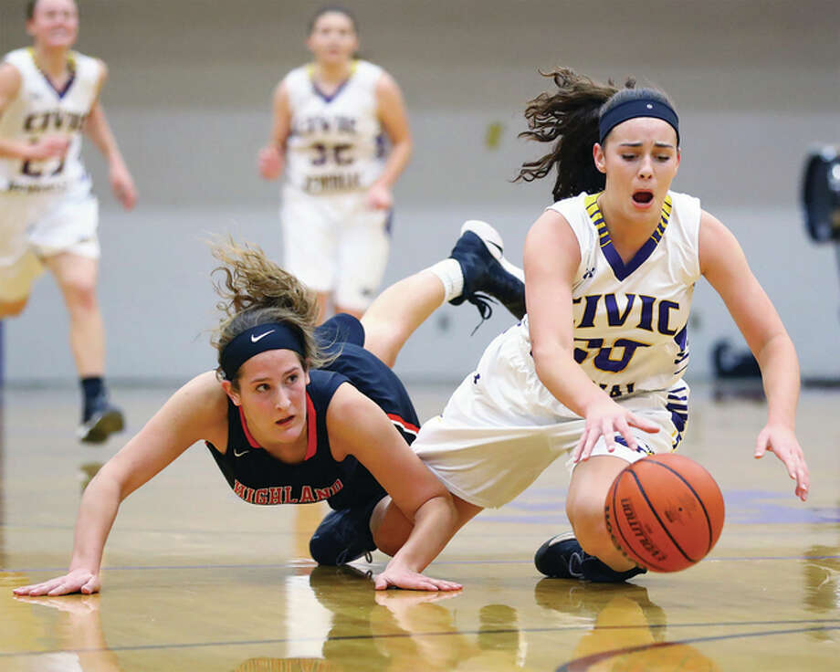 Civic Memorial's Anna Hall (right), shown beating Highland's Alex LaPorta to a loose ball during a Dec. 20 game in Bethalto, was injured during the Eagles victory Tuesday at the Roxana Class 3A Regional. Photo: Billy Hurst / Telegraph File Photo