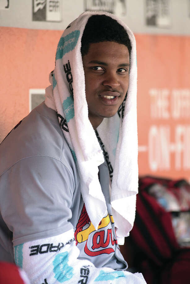 Cardinals pitcher Alex Reyes ices his right elbow in the dugout during a game last season in San Francisco. Reyes injured that elbow in spring training and will undergo Tommy John surgery to repair it.