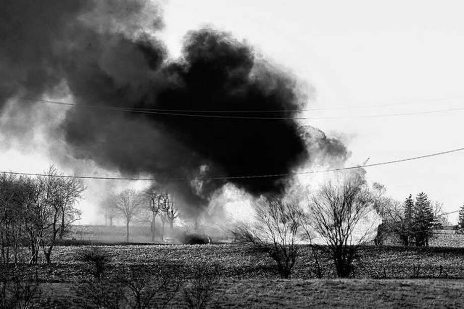 Fire rages at the scene of a natural gas pipeline explosion that sent flames and dark smoke into the air Tuesday outside of Dixon. The Lee County Sheriff's Department says the explosion happened on a farm near Nachusa.