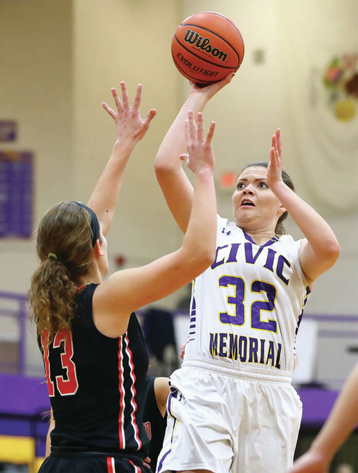 CM junior Alaira Tyus (32) scored 21 points to lead her team past Triad 66-43 Thursday night in the championship game of the Roxana Class 3A Regional Tournament. Photo: Telegraph File Photo