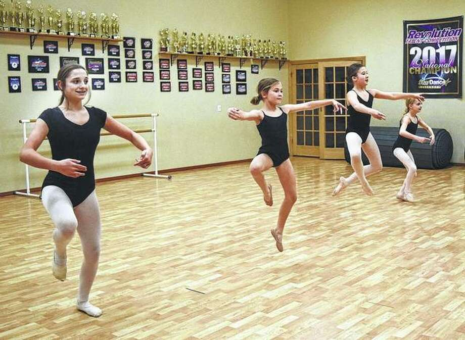 "Meredith Gallo (from left), Emma Wolters, Lilly Hickox and Kennedi Slocum practice at Sara's School of Dance for their roles in Springfield Dance Company's ""The Nutcracker."" Jocelyn Fuhr also is performing. Photo: Audrey Clayton 