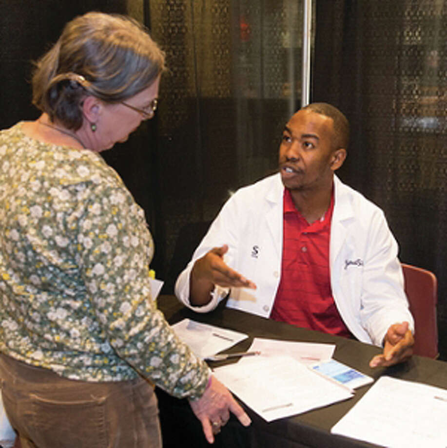 School of Pharmacy student Jamal Sims visits with a Highland resident at SIUE's 11th annual Free Diabetes Education Program. Photo: For The Telegraph