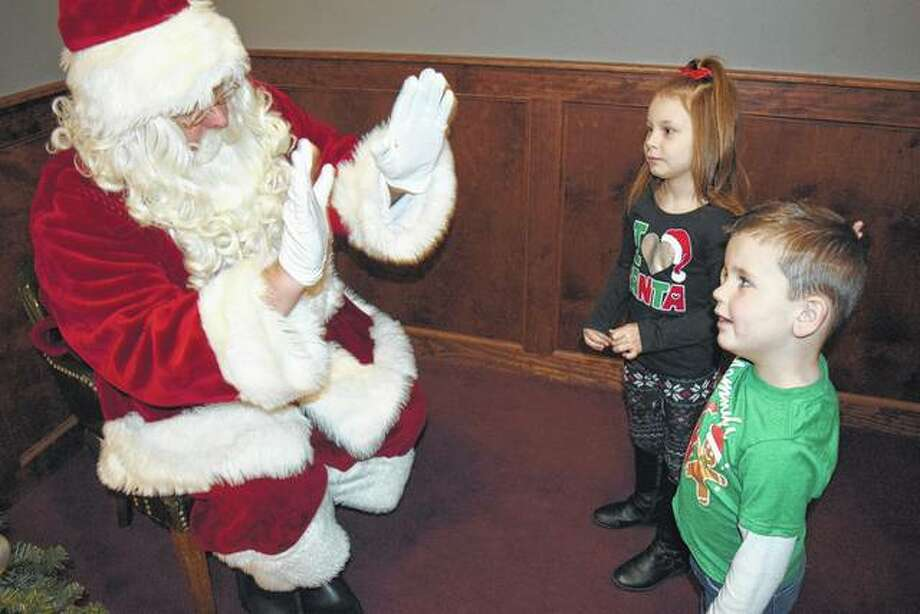 Santa Claus greets Kenny Birdsell, 4, and his sister, Adley Birdsell, 6, Saturday morning at Breakfast with Santa at the Elks Club. Kenny and Adley are the children of Ashley and Kenny Birdsell of Jacksonville.