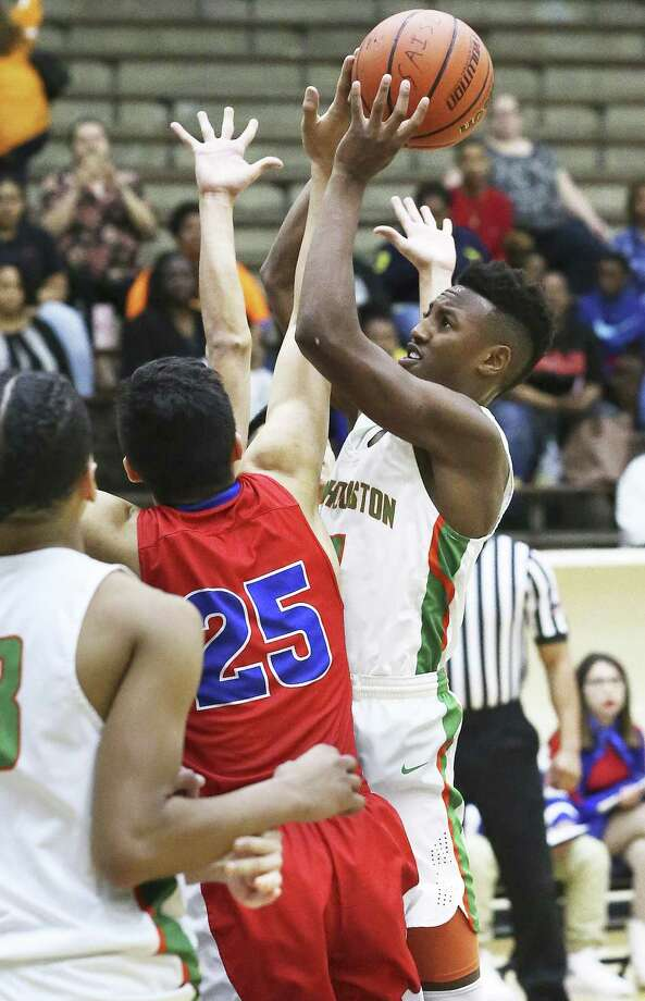 Sam Houston's Tyshaun Huey (right) goes up for a jumper as the Jefferson defense closes in around him during Friday's game at the Alamo Convocation Center. Photo: Tom Reel / San Antonio Express-News / 2017 SAN ANTONIO EXPRESS-NEWS
