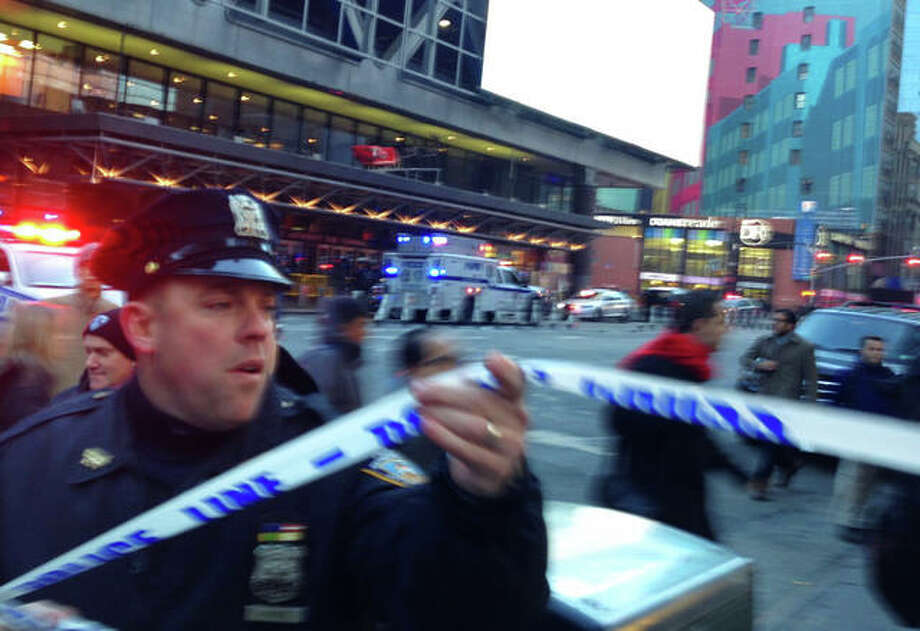 Charles Zoeller | AP Police respond to a report of an explosion near Times Square on Monday in New York.