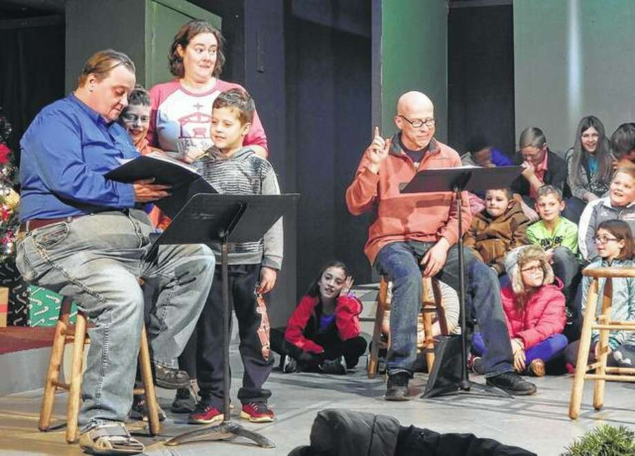 "Members of the cast of ""A Christmas Story"" rehearse Tuesday at Playhouse on the Square. The radio-play version of the Christmas classic will be performed Friday, Saturday and Sunday at the Playhouse. Photo: Angela Bauer 