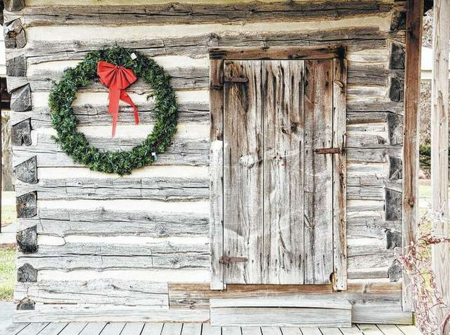 A simple wreath serves as a Christmas greeting to those passing by this cabin on the edge of Greenfield. The cabin was moved from Rockbridge a few years ago.