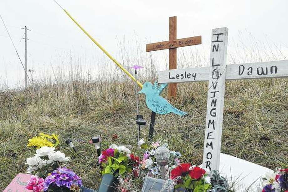 The upper cross is a replacement for one that was stolen from the memorial site near where Lesley Bricker, 16, died in a two-vehicle accident in July east of Roodhouse. The new cross, made by students at Brussels High School, was installed Dec. 8. Photo: Greg Olson | Journal-Courier