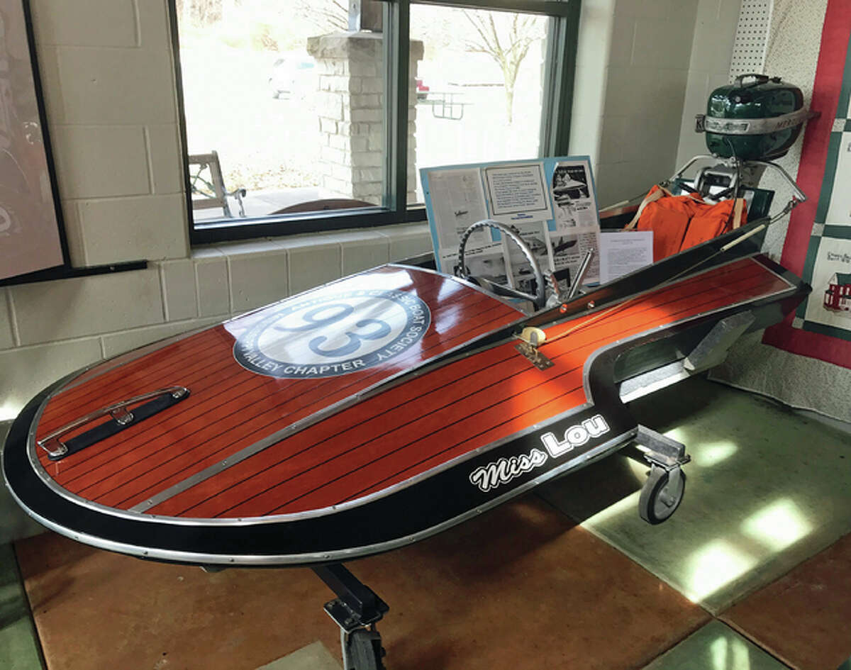 """A """"pumpkin seed boat,"""" a three-point hydroplane, owned by Tom and Lou Lenkman, of Grafton, was restored by volunteers at the Mississippi Valley Chapter of the Antique Classic Boat Society as a club project."""