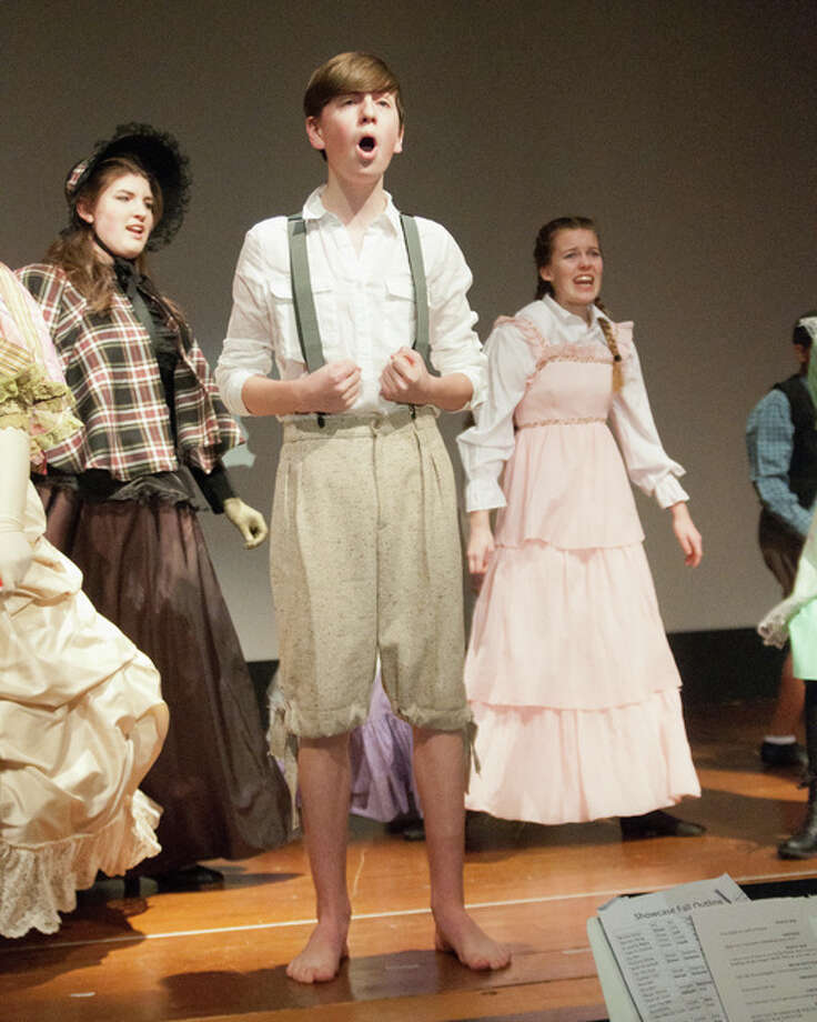 Caleb Kelahan from Edwardsville plays Tom Sawyer, the lead character in the musical that includes students from all over the Metro East area. Photo: Dan Cruz | For The Telegraph