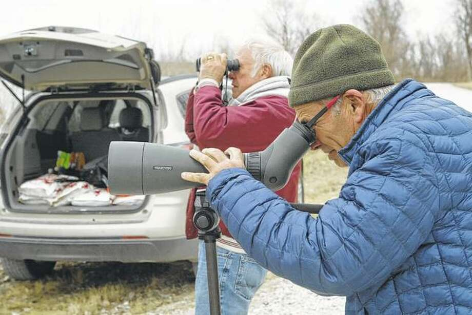 Pat Ward of rural Murrayville (left) and Tony Ward of Jacksonville look for birds Friday north of Meredosia. The Wards were helping with another Christmas bird count for the National Audubon Society and the Illinois Ornithological Society.