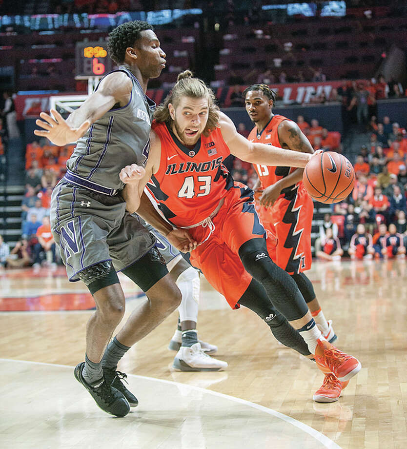 Illinois forward Michael Finke (43) collides with Northwestern's Vic Law (4) Tuesday night in Champaign. Photo: AP