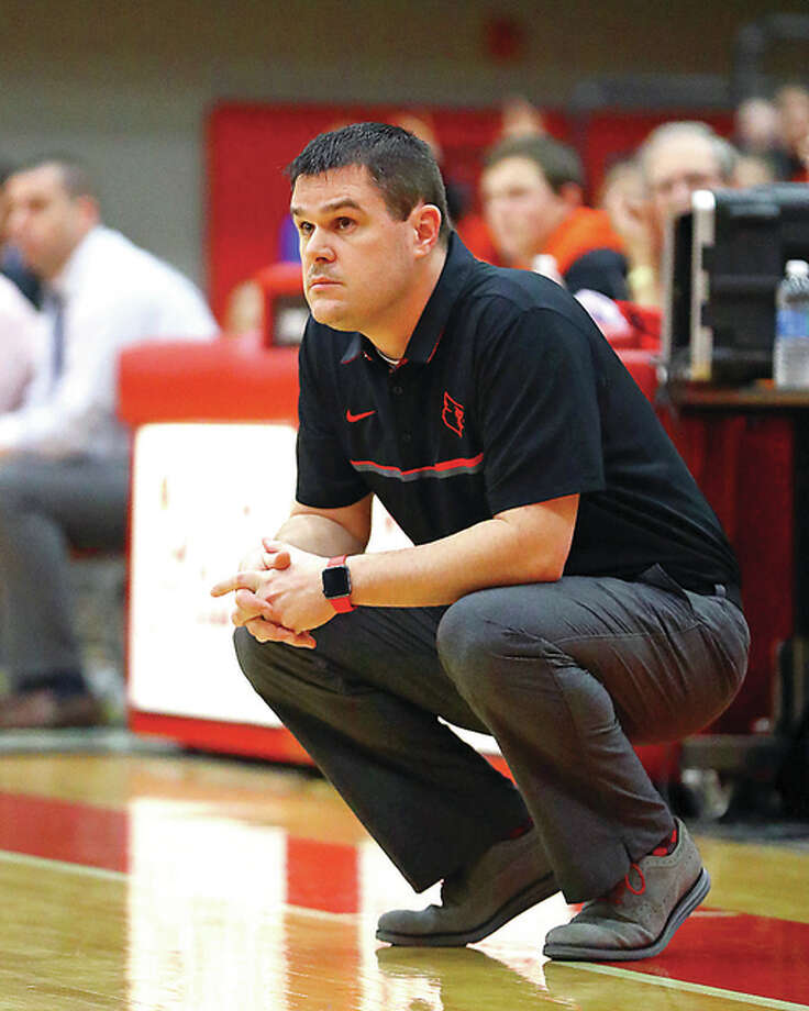Alton coach Eric Smith's team dropped a 52-41 Southwestern Conference home decision to Belleville West Tuesday night. Photo: Billy Hurst File Photo | For The Telegraph