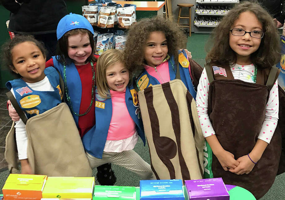 Members of Troop 224 in Wood River pose for a photo while selling Girl Scout cookies recently.