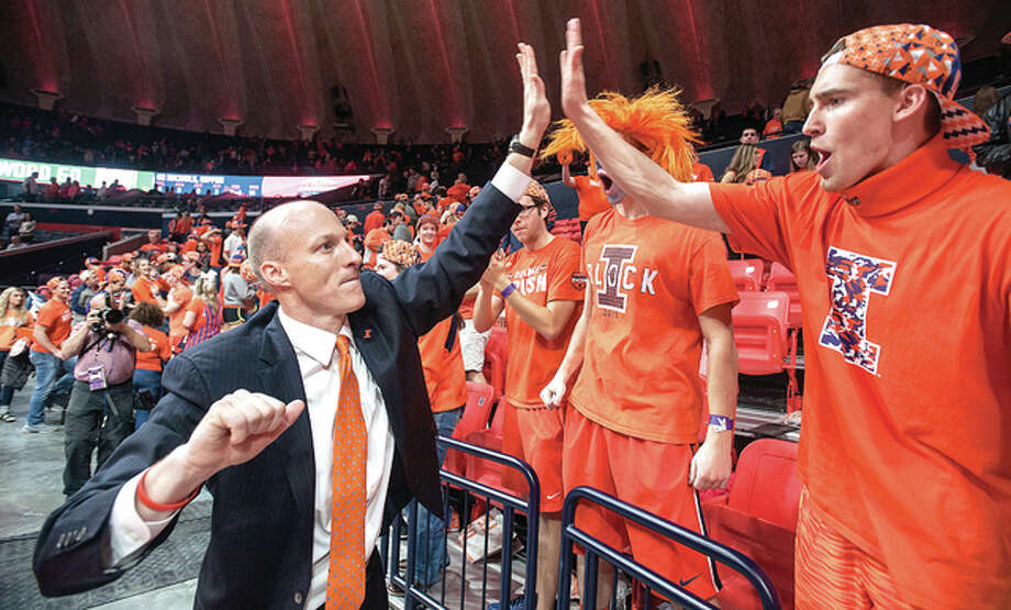 Illinois coach John Groce celebrates with members of the student section Orange Krush in the second half of his team's win Tuesday night over Northwestern in Champaign. Photo: AP