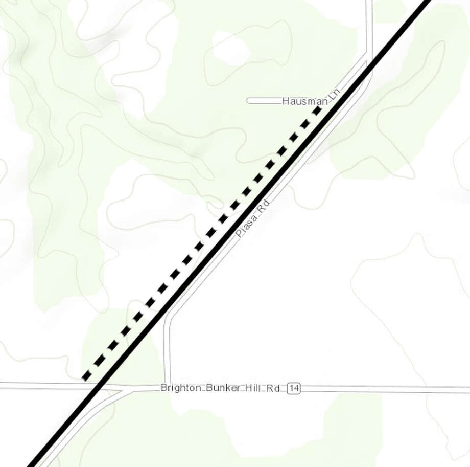 A striped line represents a proposed bypass on Piasa Road, which residents hope will resolve their woes after a railroad crossing was removed.