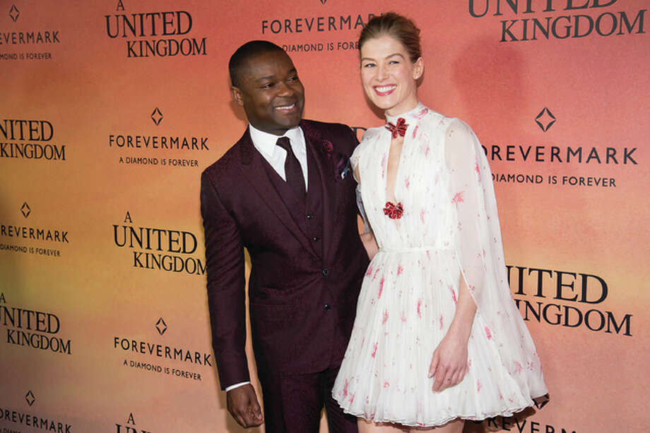 "David Oyelowo, left, and Rosamund Pike attend the world premiere of Fox Searchlight's ""A United Kingdom"" at the Paris Theatre on Monday, Feb. 6, in New York. Photo: (Photo By Charles Sykes/Invision/AP)"