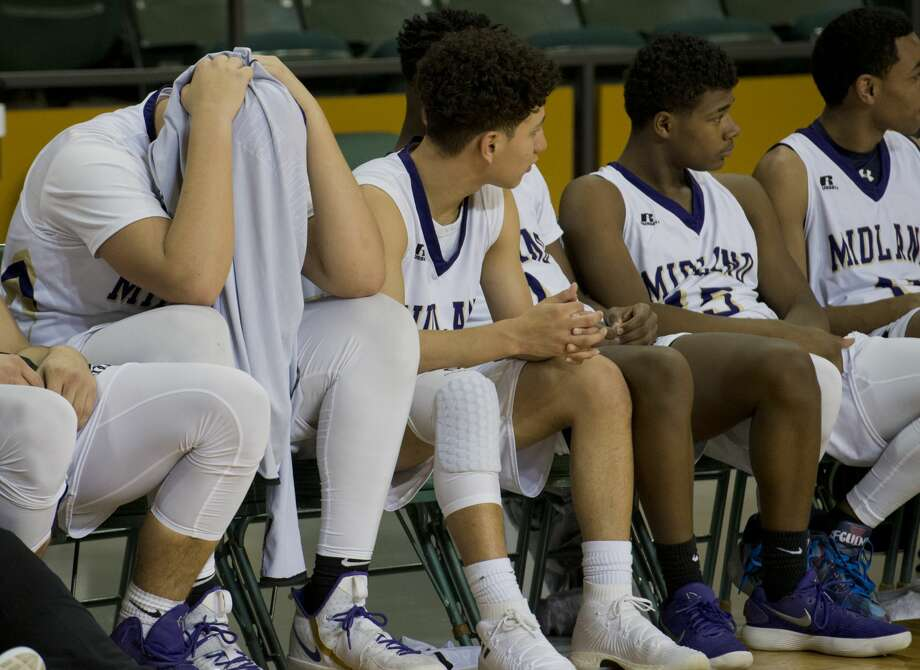 Midland High's Brett Canis can't watch the end of the game 02/09/18 at the Chaparral Center as he and teammates fall to Frenship to end thier season. Tim Fischer/Reporter-Telegram Photo: Tim Fischer/Midland Reporter-Telegram