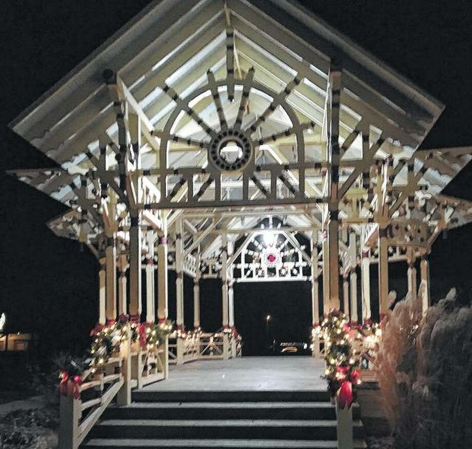 The bandstand at the Prairie Land Heritage Museum glows with Christmas decorations for the holiday.