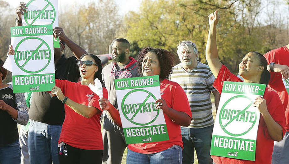 Holding signs and chanting slogans, members of the American Federation of State, County and Municipal Employees protest in November outside the Alton Mental Health Center on Illinois Route 140 in Alton.