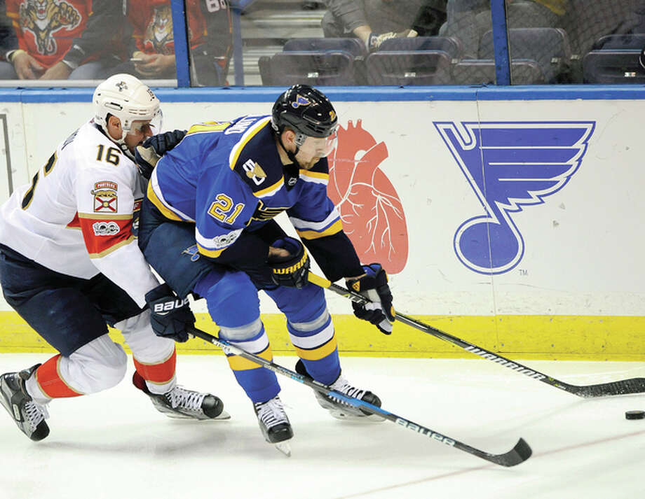 (16), of Finland, reaches for the puck with The Blues' Patrik Berglund (21) races for the puck against the Florida Panthers' Aleksander Barkov in a game Monday. Berglund signed a five-year deal with the Blues Friday. Photo: AP