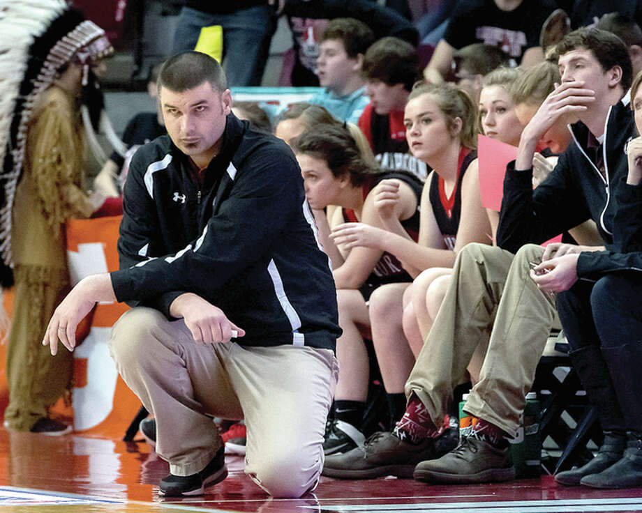 Calhoun head coach Aaron Baalman, left, watches the action late in his team's loss to Mendon Unity in the Class 1A state semifinals in Normal. Photo: Michael Weaver | For The Telegraph