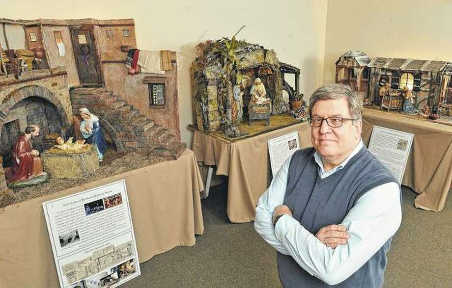 Michael DeSanctis, a fine arts, pastoral studies and theology professor at Gannon University, stands amid several Nativity scenes he created — in 2015 (from left), 2016 and 2014 — that are on display at First Presbyterian Church of the Covenant in Erie, Pennsylvania. DeSanctis said he works on one Nativity scene all year, sometimes several hours a day, built around figurines he salvages from churches that close or replace older scenes. He tries to make as much of each scene as possible from repurposed materials. Photo: Christopher Millette | Erie Times-News | AP