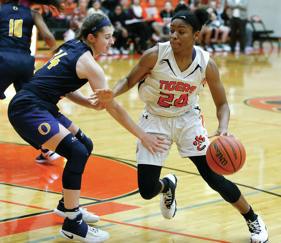 Edwardsville's Myriah Noodel-Haywood (right) drives on O'Fallon's Caitlin Kayser during a Tigers' SWC win Jan. 5 in Edwardsville. Noodel-Haywood scored 10 points in the Tigers' victory Monday night at the Bloomington Class 4A Super-Sectional. Photo: Scott Kane / For The Telegraph
