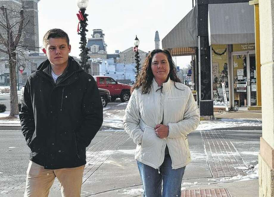 April and Luke Coop of Jacksonville hurry to get to their destination Tuesday as temperatures hover around 10 degrees. Photo: Audrey Clayton | Journal-Courier