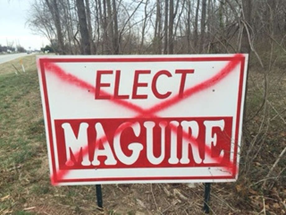 """The red-and-white """"Elect Maguire"""" sign shown defaced with a large red """"X"""" sprayed across its front. Wood River councilwoman and mayoral candidate Cheryl Maguire said she has never been the target of such vandalism in her four previous races for Wood River public office."""