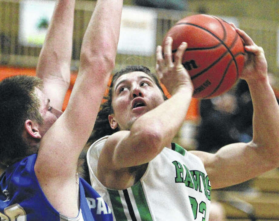 Carrollton's Jerrett Smith (right), shown looking to shoot over a North Greene defender during action at the Beardstown Tourney on Jan. 27, and the Hawks ended their season Tuesday with a loss to the host Rockets in the Okawville Class 1A Sectional. Photo: Dennis Mathes / Journal-Courier