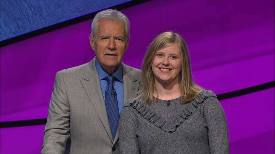 Jacksonville native Meghan Whalen stands with Jeopardy host Alex Trebek during the taping of her episode of Jeopardy in October.