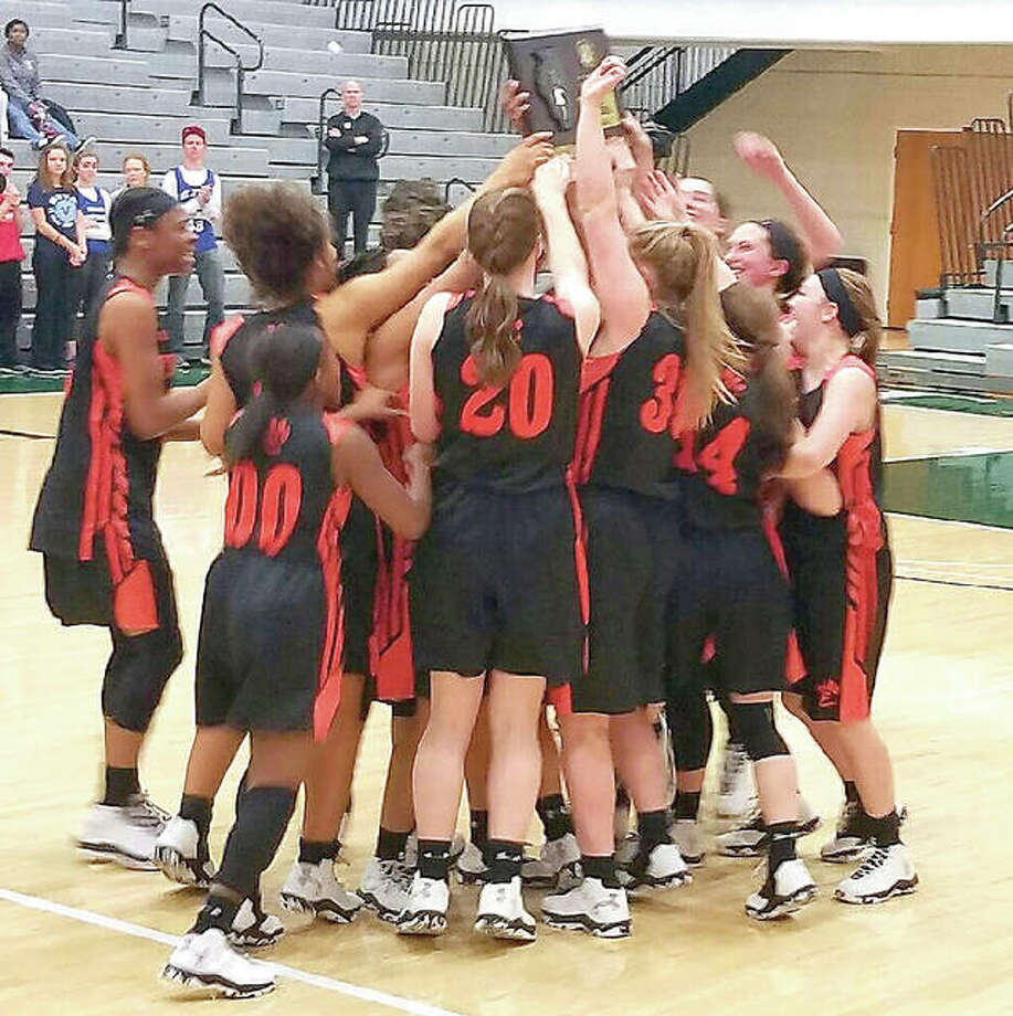 Members of the Edwardsville girls basketball team celebrate their victory over Lisle Benet Academy this week in the IHSA Class 4A Illinois Wesleyan Super-Sectional at the Shirk Center in Bloomington. Photo: Submitted Photo