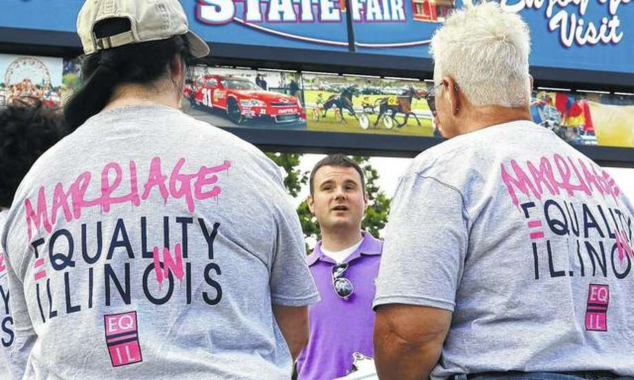 "Randy Hannig of Equality Illinois hands out shirts supporting gay marriage in Springfield in 2013. Starting in January, Illinois is outlawing a rare criminal defense argument allowing the use of a victim's sexual orientation as justification for violent crime. It's a ban that gay rights advocates hope to replicate in about half a dozen states next year. Illinois follows California in outlawing the so-called ""gay panic defense."" It isn't common, but one study shows it's surfaced in roughly half of U.S. states since the 1960s. Photo: Seth Perlman 