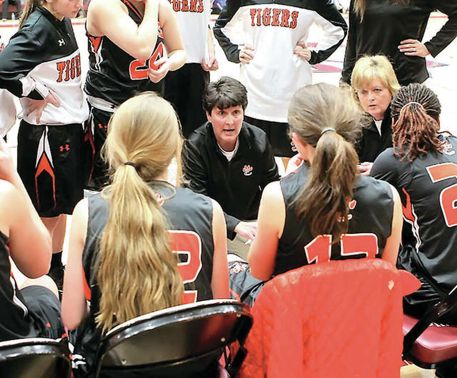 Edwardsville coach Lori Blade, center, and her No. 3-ranked Tigers (shown last season) will take on No. 1 Lombard Montini in Class 4A state semifinal game at 5:30 p.m. Friday at ISU's Redbird Arena in Normal. Photo: Telegraph File Photo