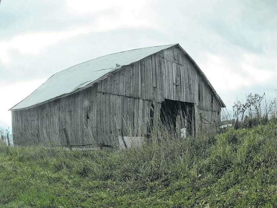An old barn sits on a hillside in rural Macoupin County.