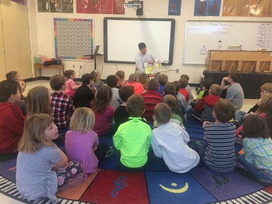 Davis reads to Ben-Gil Elementary students in Gillespie to recognize Read Across America Day.