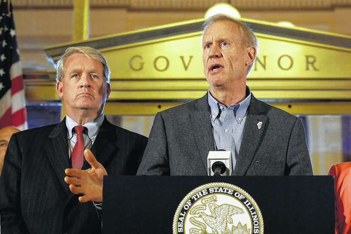Gov. Bruce Rauner speaks to reporters in front of his office at the Capitol in Springfield. Illinois got its first state budget since 2015 after Democrats in the Legislature, joined by roughly a dozen Republicans, override Rauner's vetoes of a spending plan and income tax increase.The story was chosen as one of Associated Press year's 10 biggest stories or 2017 in Illinois.