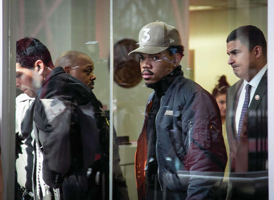 Grammy-winning artist Chance the Rapper walks out of the Thompson Center in Chicago after a meeting with Illinois Gov. Bruce Rauner on Friday, March 3. Photo: (Ashlee Rezin/Chicago Sun-Times Via AP)