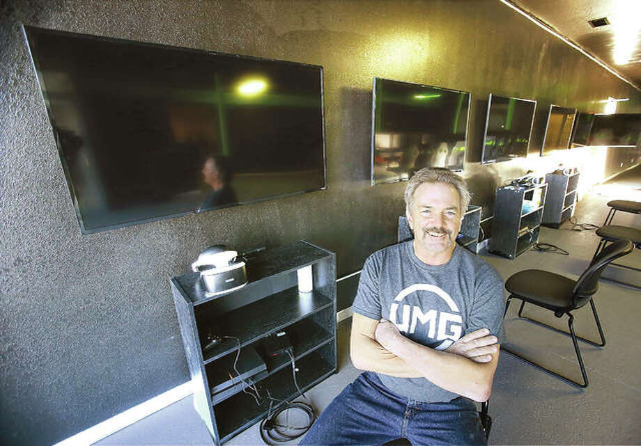 Randy Scism sits in the large video gaming room of the recently opened Riverbend Battles, 627 East Airline Drive in East Alton, near Rosewood Heights. Scism said he hopes the business offers youth a safe place to hang out and socialize with friends after school.