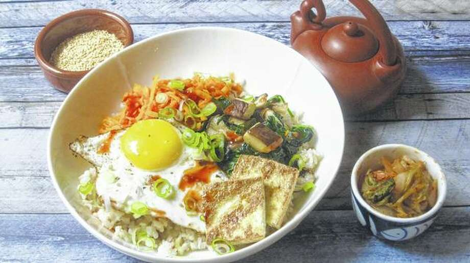 A Korean grain bowl combines flavorful, filling ingredients that can help sustain one's resolution to eat healthier in the new year. Photo: Sara Moulton | Associated Press