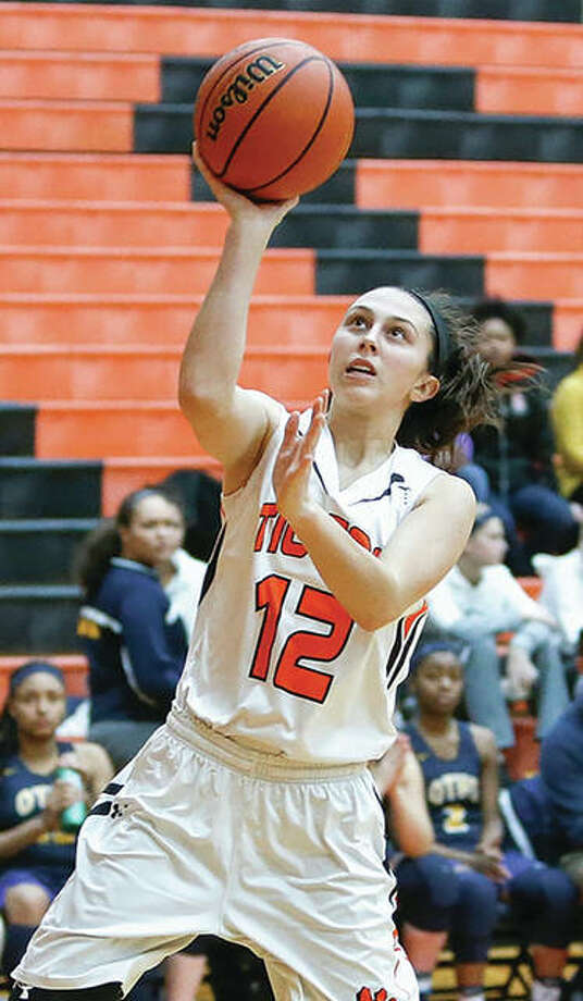 Edwardsville's Makenzie Silvey, shown in action earlier this season, hit the game-winning jumper in Friday's semifinal to send the Tigers to Saturday night's Class 4A state championship game. Photo: Scott Kane / For The Telegraph